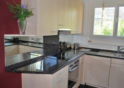 Modern kitchen, black granite counters, floor tiles with floor heating…